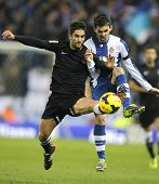 BARCELONA - NOV, 30: Markel Bergara(L) of Real Sociedad vies with Victor Alvarez(R) of Espanyol duri