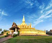 Laos travel landmark, golden pagoda wat Phra That Luang in Vientiane.  Buddhist temple. Famous tourist destination in Asia.