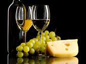 Bottle Of Wine, A Bunch Of White Grapes And A Piece Of Cheese