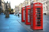 image of phone-booth  - Three red booths on a row in the street on Edinburgh - JPG