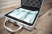 Russian Rubles In Order Inside Of Steel Suitcase, On Wooden Floor