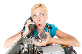 picture of computer technology  - confused woman phoning technology support for computer - JPG