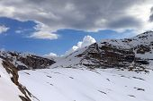 foto of taurus  - Snow rocks and cloudy sky - JPG