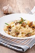 Vegetarian dish with tagliatelle and mushrooms