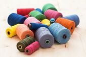 Tailoring. Many colorful threads on the table