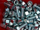 Nuts And Bolts In Red Bin