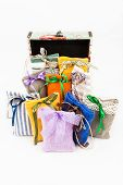 foto of sachets  - Decorative textile sachet pouches with gift box on white background - JPG