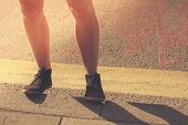 Closeup On A Young Woman's Legs In The Street