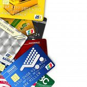 A bunch of fake credit cards over white with clipping path - all logos, names, number and designs ar