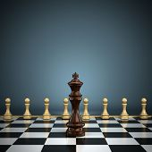 King with pawns on chessboard symbolizing leadership or battle. Shallow depth of field with focus on the king.