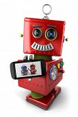 Happy vintage toy robot with smartphone over white background