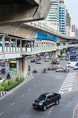 Multilevel Bangkok With Traffic On Street, Pedestrian And Skytrain Tracks