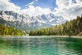 foto of bavarian alps  - An image of the Eibsee and the Zugspitze in Bavaria Germany - JPG