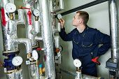 repairman engineer or inspector of fire engineering system or heating system with valve equipment in