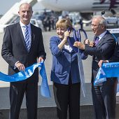 BERLIN, GERMANY - MAY 20, 2014: German Chancellor Angela Merkel (C), Turkish Minister of transport L