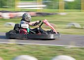 The child participates in race on a go-cart in carting club