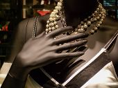 foto of dress mannequin  - Mannequin wearing necklace and dress in a clothing store - JPG