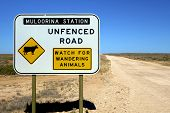 foto of wander  - An Unfenced Road sign in outback Australia warning about wandering animals - JPG