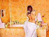 stock photo of bubble-bath  - Woman relaxing at water in bubble bath - JPG