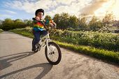 Riding a bicycle for the first time on a country road concept for healthy lifestyle, exercising and