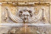 An ancient cherub fountain on the island of Malta.