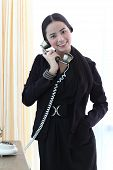 Young Bussiness Woman Using A Telephone