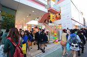 Tokyo - November 24 : People Walk Through Takeshita Dori Near Harajuku Train Station