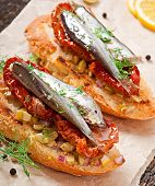 Crostini with anchovies, olives and sun-dried tomatoes