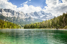 stock photo of bavaria  - An image of the Eibsee and the Zugspitze in Bavaria Germany - JPG