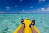 foto of canoe boat man  - Caucasian man is kayaking in sea at Maldives - JPG