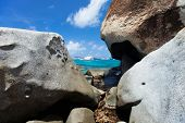 Stunning beach with unique huge granite boulders, turquoise ocean water and blue sky at Virgin Gorda, British Virgin Islands in Caribbean