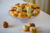 Profiterole cream puff - French dessert choux pastry ball filled with whipped cream
