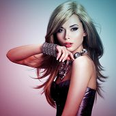 Portrait of a beautiful young woman with long hair.   Concept image is in tinting colorize style
