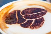 Cappuccino with a coffee bean drawing