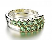 Golden Engagement Ring with emerald. Jewelry background
