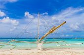 philippino-style wooden sail boat, boracay island, tropical summer vacation