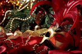 magic Christmas background with golden carnival mask