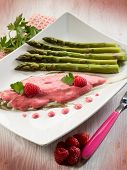 sole fish with raspberry cream and asparagus