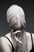 Woman Covering Face With Cloth, Making Hand Sign
