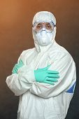 Scientist in Hazmat suit and protective gear with arms crossed