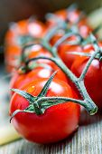 stock photo of roughage  - Fresh cherry tomatoes on the wooden background - JPG