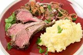 image of lamb chops  - Lamb chops cut from a roast lamb rack and served with creamed garlic potato and onion relish - JPG