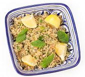 Turkish bulgur wheat salad, known as kisr, made with mint, cucumber,  lemon, romato and parsley, seen from above