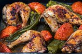 Chicken roasted with tomatoes and long sweet peppers