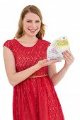 Pretty blonde in red dress showing her cash on white background