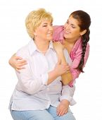 Happy senior woman with her daughter isolated