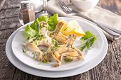 fried frog leg with parsley