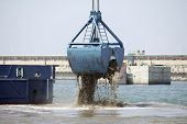 foto of dredge  - Dredging in a Industrial Harbor near Casablanca in Morocco - JPG