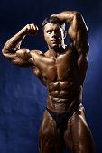 Strong Athletic Man Fitness Model Torso Showing Big Muscles.