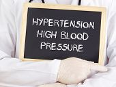 stock photo of hypertensive  - Doctor shows information - JPG